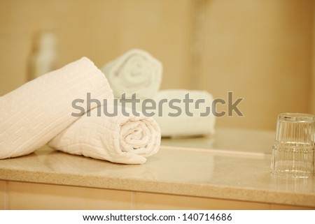 Closeup of rolled napkins on counter against mirror
