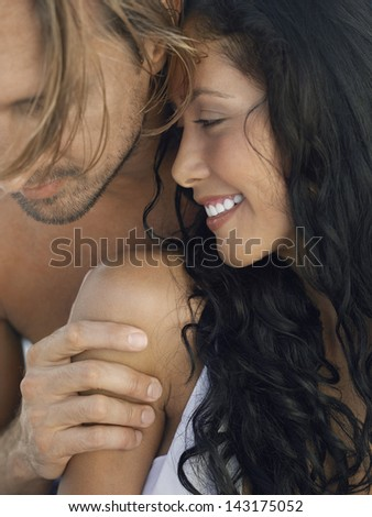 Closeup of romantic young couple spending time together - stock photo