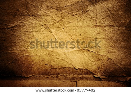 Closeup of rough brown paper texture background - stock photo