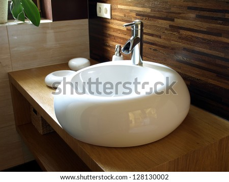 Closeup of round white sink in modern bathroom - stock photo