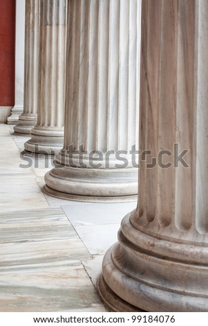 Closeup of row of neoclassical Greek columns in the porch of the archaeological museum of Athens, Greece. - stock photo