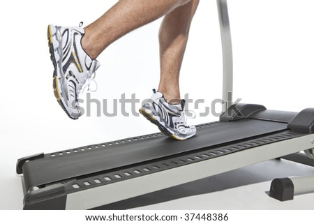 Closeup of running man using treadmill - stock photo