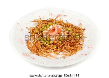 Closeup of russian salad with salmon fish at fried sliced potato - stock photo