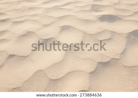 closeup of sand pattern of a beach in the summer/sand texture - stock photo
