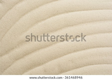 closeup of sand pattern on a beach in the summer - stock photo