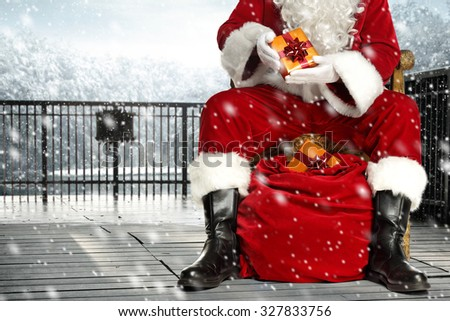 closeup of santa claus sack and legs in black shoes