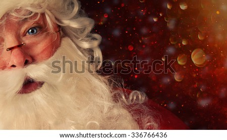 Closeup of Santa Claus with a magical holiday background