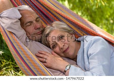 Closeup of senior Caucasian couple in hammock - stock photo