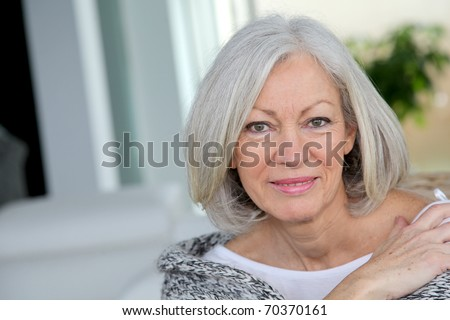 Closeup of senior woman relaxing at home - stock photo