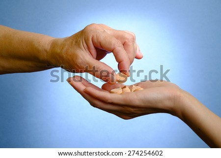 Closeup of senior woman's hand holding medications - stock photo
