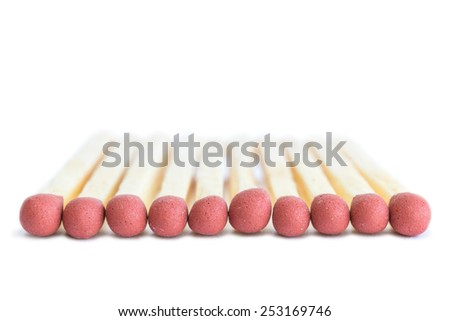 Closeup of several matches viewed from the front, isolated on white background - stock photo