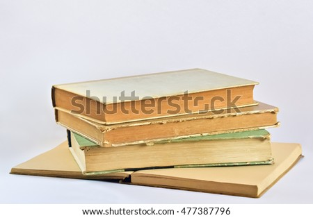 Closeup of several old books on bright background