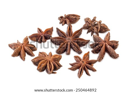 Closeup of several star anises (star aniseed or Chinese star anise) isolated on white background - stock photo