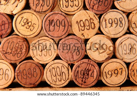 Closeup of several wine corks with the vintage year stamped into the end.