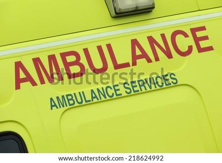 Closeup of sign on NHS ambulance vehicle - stock photo