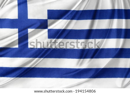 Closeup of silky Greek flag - stock photo