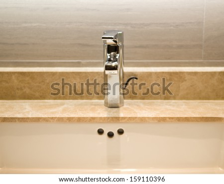 Closeup of sink and faucet in modern bathroom. - stock photo