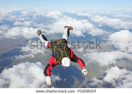 Closeup of skydiver in freefall - stock photo