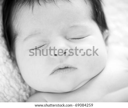 closeup of sleeping newborn in black and white - stock photo