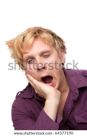 Closeup of sleepy young man on white background