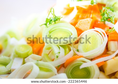 Closeup of sliced leek and carrot - stock photo