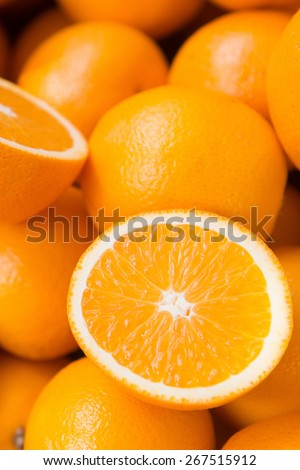 Closeup of sliced oranges on a local market - stock photo