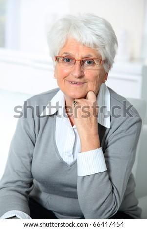 Closeup of smiling elderly woman - stock photo