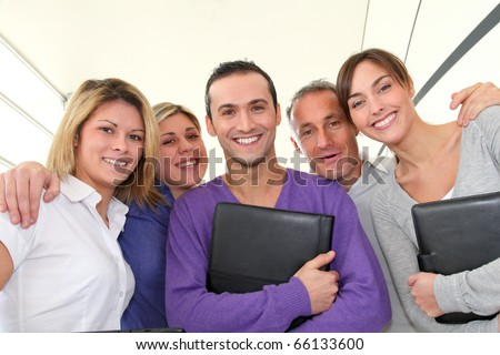 Closeup of smiling group of office workers - stock photo