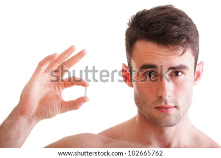 Closeup of smiling man holding pills isolated on white - stock photo