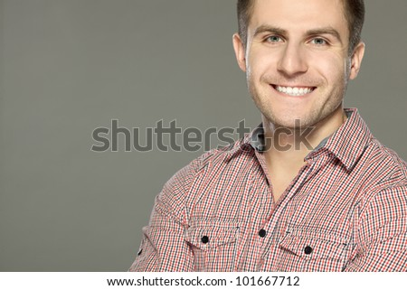 Closeup of smiling man, over gray background - stock photo