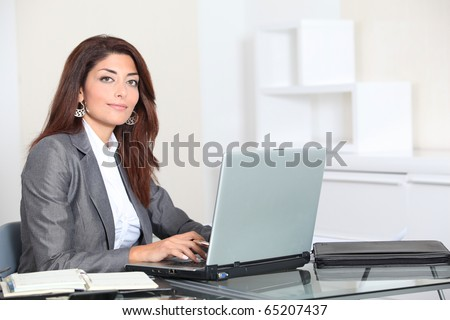 Closeup of smiling real estate agent in office - stock photo