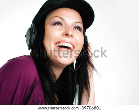 closeup of smiling young brunette teenager listening music in headphones