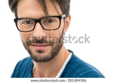 Closeup of smiling young man wearing eyeglasses - stock photo