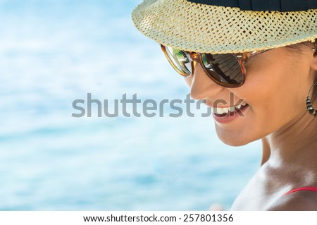 Closeup Of Smiling Young Woman Wearing Sunglasses - stock photo