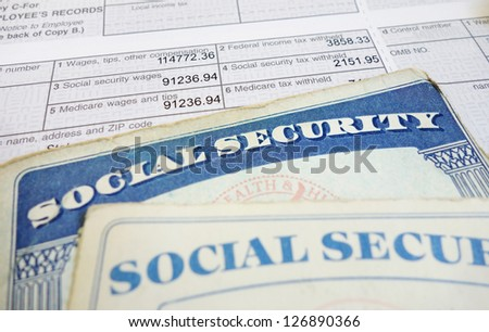 Closeup of Social Security cards and W2 wage form - stock photo