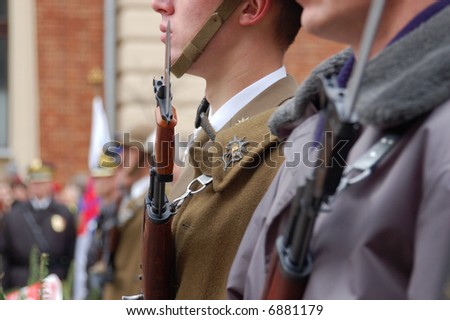 Closeup of soldiers performing duty of honor guard by Tomb of Unknown Soldier on Independence Day of Poland - Krakow