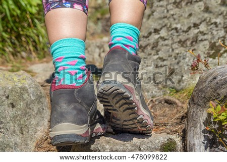closeup of sole of woman hiking boots in mountains