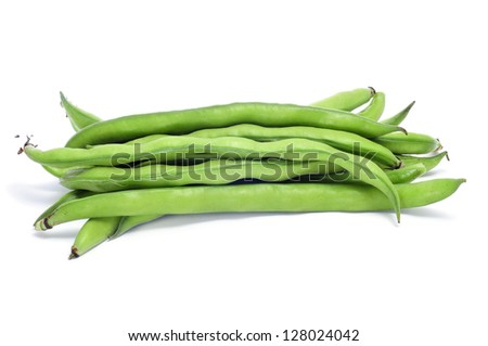 closeup of some broad bean pods with the beans inside on a white background - stock photo