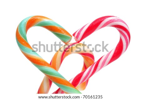 closeup of some candy canes isolated on a white background - stock photo