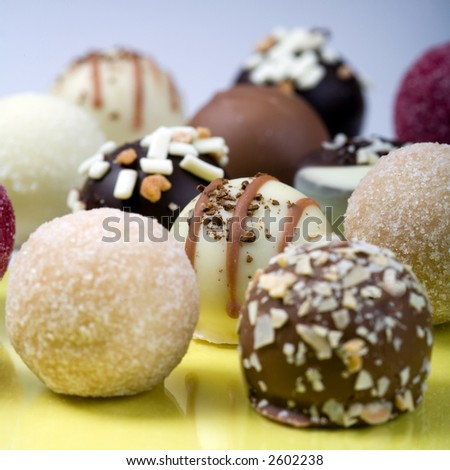 Closeup of some truffles on yellow and blue background. - stock photo