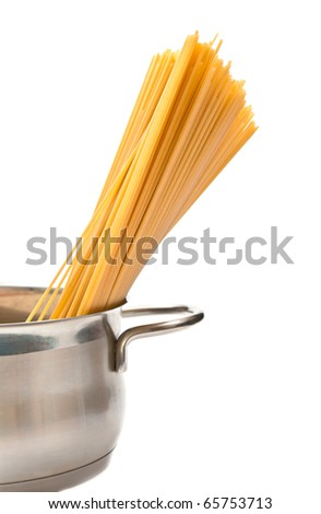 Closeup of spaghetti in pan isolated on white background