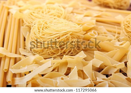 closeup of spaghetti, noodles and penne rigate - stock photo