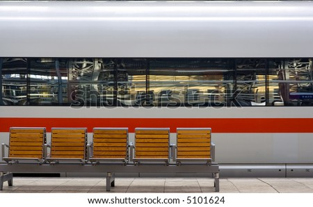 Closeup of speedtrain in station with seats in front.