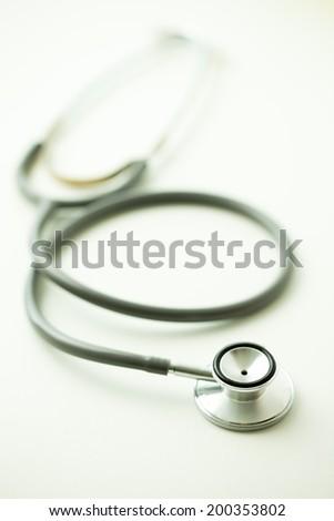 closeup of stetoscope on white table - stock photo