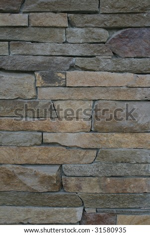 Closeup of stone wall background - stock photo