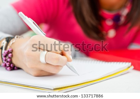Closeup Of Student Hand Writing On Paper - stock photo