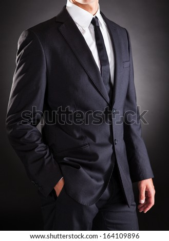 Closeup Of Successful Businessman Standing Hand In Pocket - stock photo