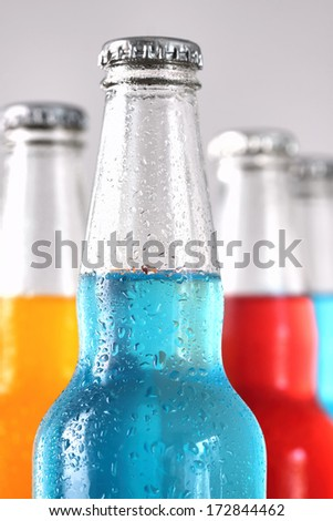 Closeup of summer drinks with ice on bright background - stock photo