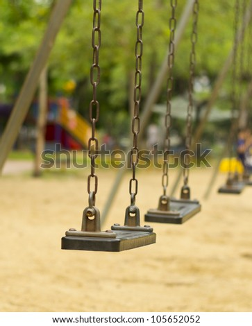 Closeup of swings in a children play area at park