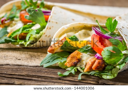 Closeup of tasty kebab with vegetables and chicken - stock photo